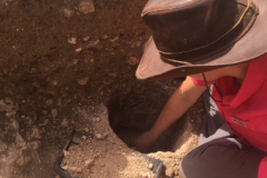 Annah excavating the posthole, which was used to hold up the porch